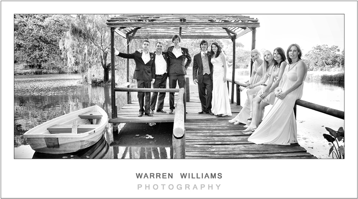 Bride, groom, bridesmaids, bestmen on jetty