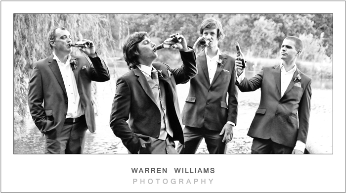 Groom and groomsmen drinking beer