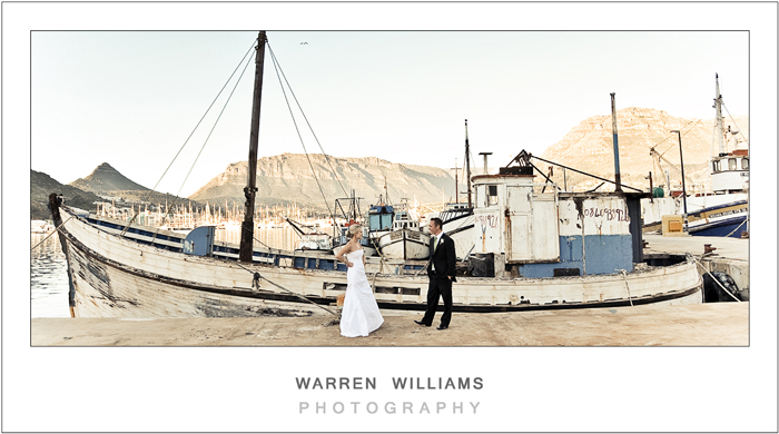 Bride and groom with fishing boat