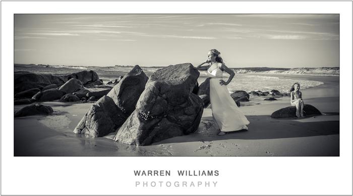 Bride and flowergirl on beach