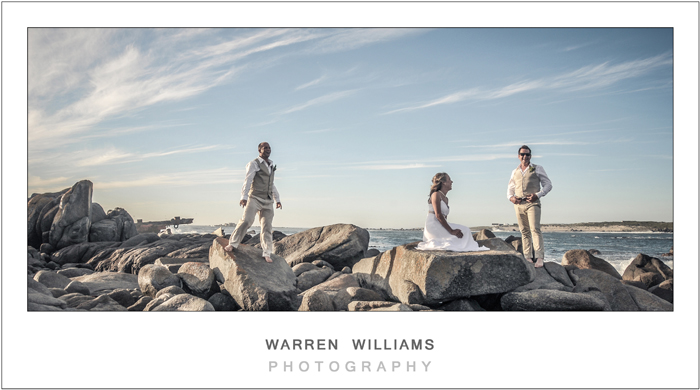 Bride, groom, bestman landscape