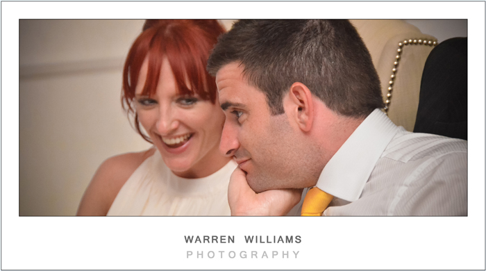 Reception laughter with groom