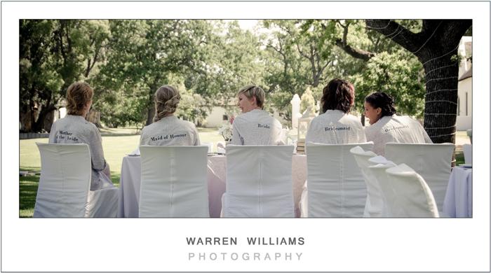 Bridesmaids, bride, mother-of-bride in garden