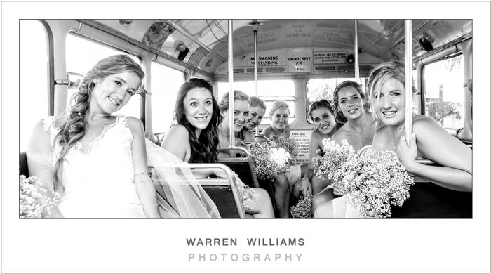 Groom with bridesmaids inside Matjiesfontein bus