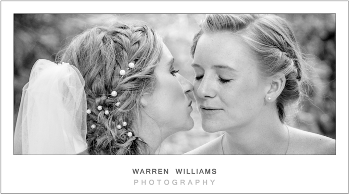 Sisters kiss before wedding ceremony