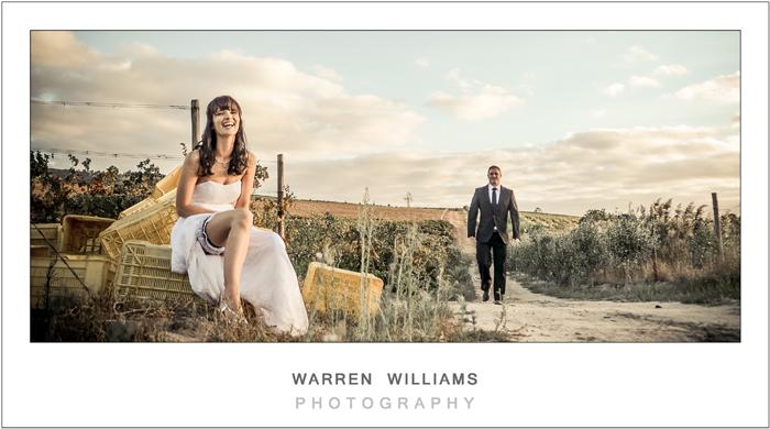 Bride and groom on farm road