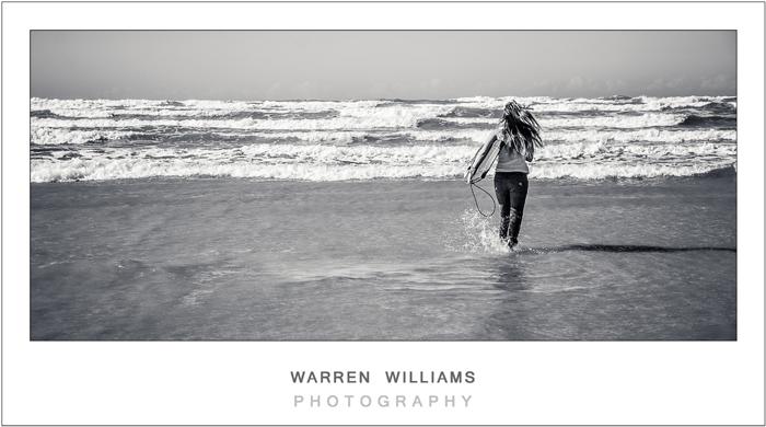Girl running into sea, bodyboard