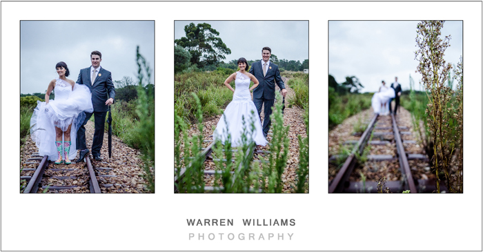 Bride and groom on train tracks in the country
