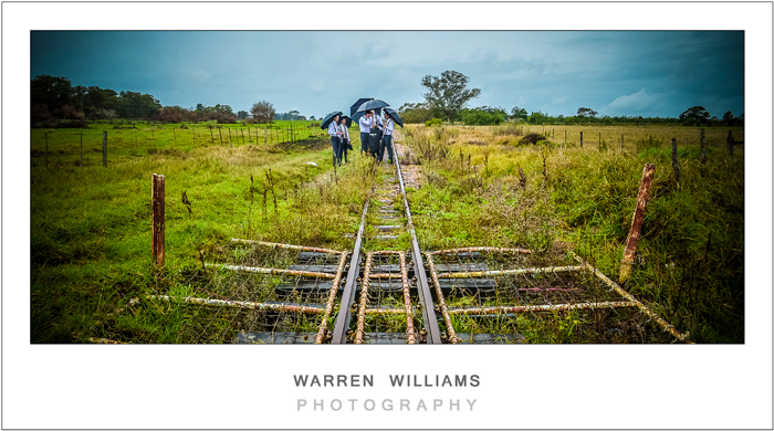 Groom and bestmen on train tracks