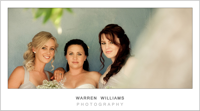Bride and bridesmaids outside room