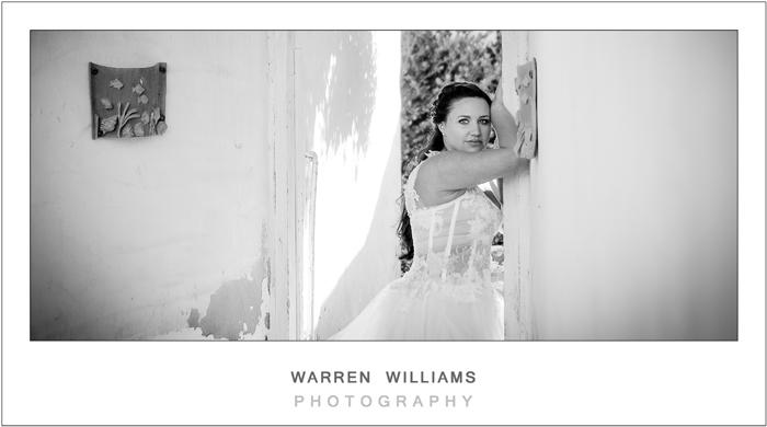 Bride posing in rustic setting