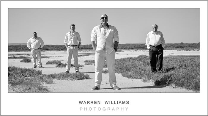 Groom and bestmen on salt pan, black and white wedding photos