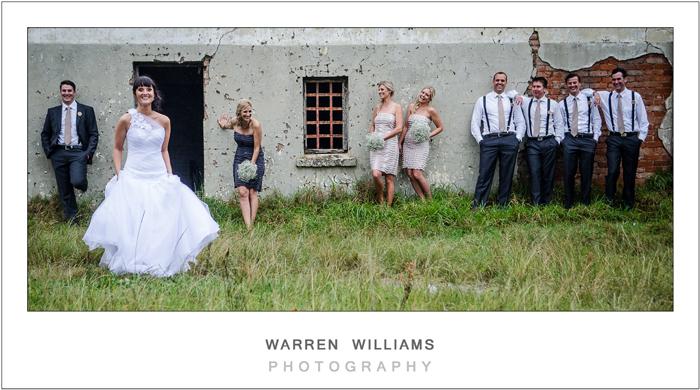 Bride, groom, bestmen, bridesmaids outside old house