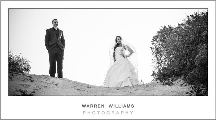 Bride and groom on sand dune