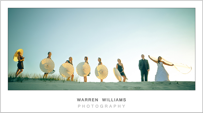 Bridal party on sand dune
