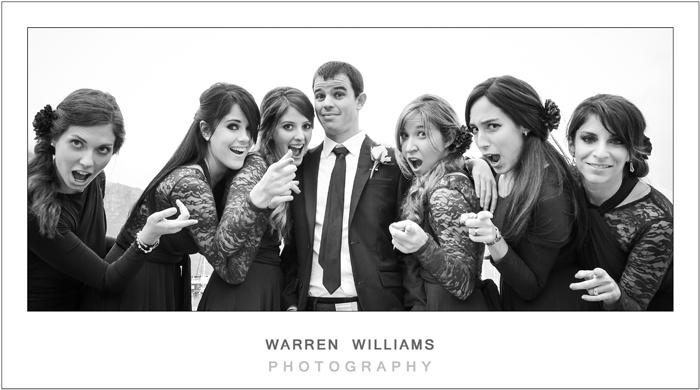 Warren Williams Photography captures groom and bridesmaids having fun in harbor