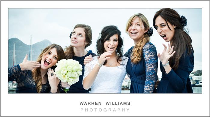 Bride enjoying fun moments with bridesmaids