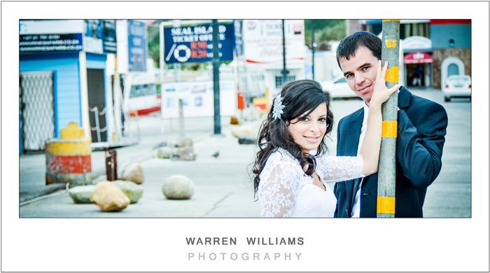 Bride and groom celebrate love in harbor