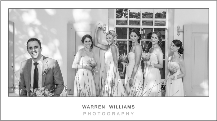Relaxed groom with bridal girls