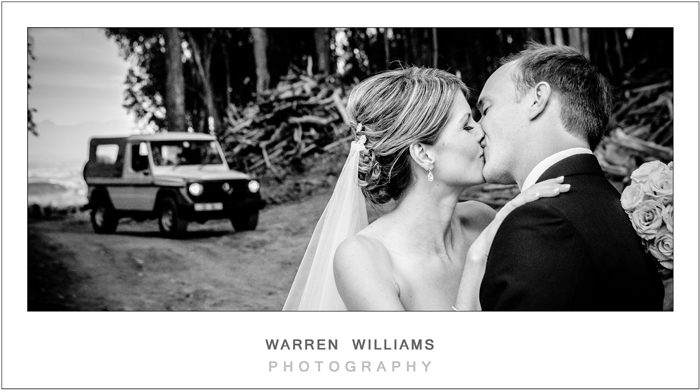bride and groom in front of land rover
