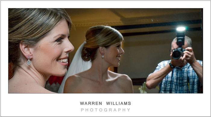 bride with her wedding photographer