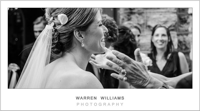 bride gets hug after ceremony