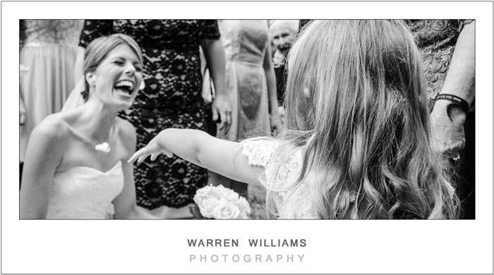 bride laughs with flower girl