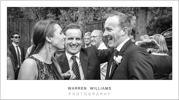 grooms lighthearted moment with guests